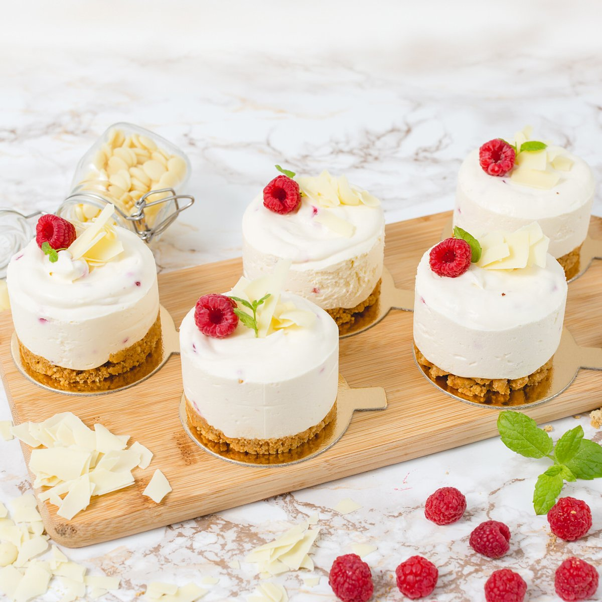 Set of 5 Individual White Chocolate and Raspberry Cheesecakes | Merci Beaucoup Cakes